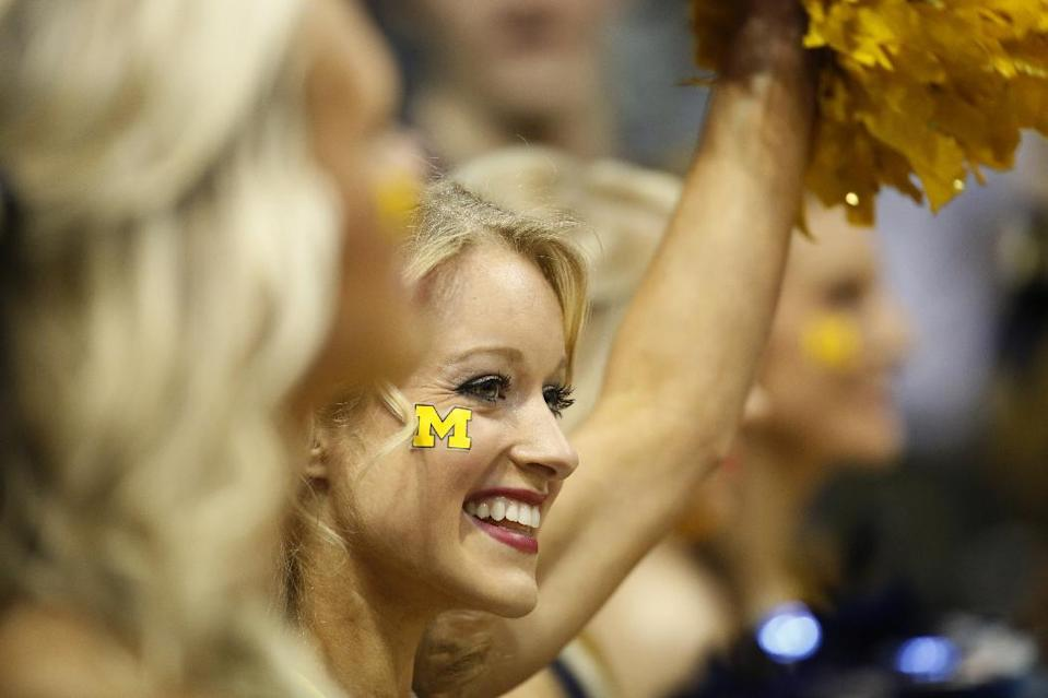 Michigan cheerleaders perform during the first half of a second round NCAA college basketball tournament game between the Michigan and the Wofford Thursday, March 20, 2014, in Milwaukee. (AP Photo/Jeffrey Phelps)