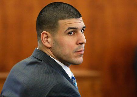 Former New England Patriots football player Aaron Hernandez sits during his murder trial in Fall River