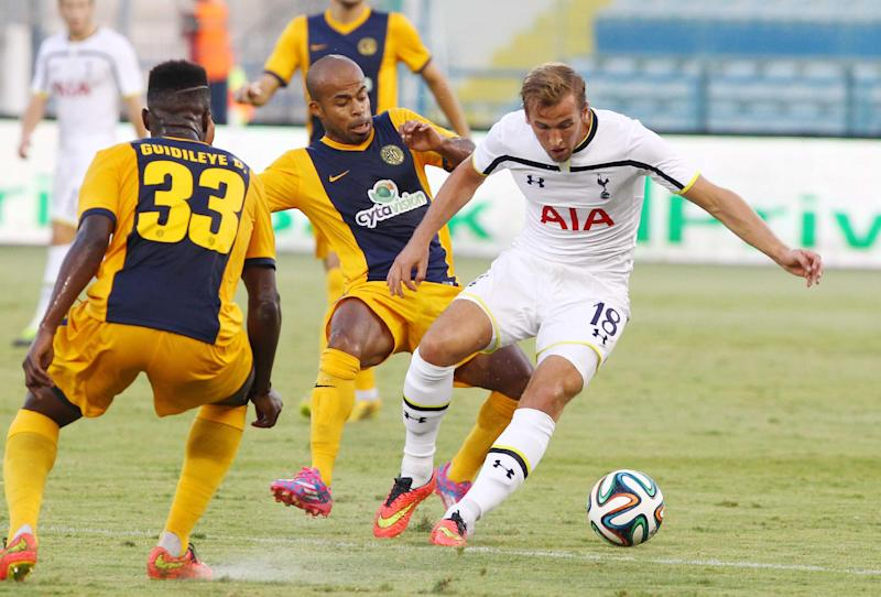 Tottenham Hotspur's player Harry Kane (R) fights for the ball against AEL Limassol's player Guidileye Dialo Sambra (L) during their 2014 UEFA Europa League Playoff football match at the Antonis Papadopoulos stadium on August 21, 2014