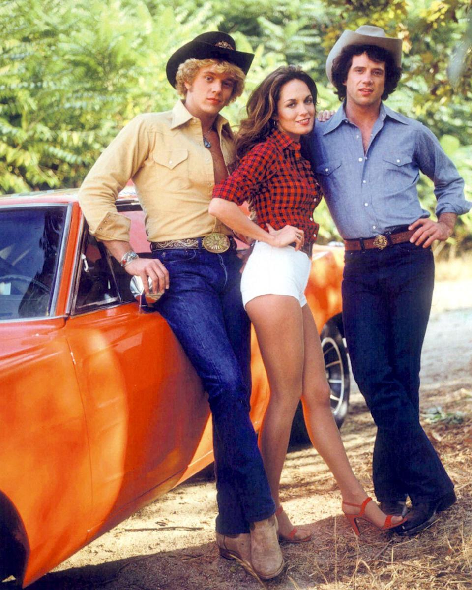 """<p>While the """"good ol' boys"""" never meant any harm, according to the show's theme song, the confederate flag atop their signature vehicle the General Lee is a symbol of racial intolerance and slavery. <a href=""""https://deadline.com/2015/07/dukes-of-hazzard-tv-land-clementa-pickney-dylann-roof-1201466719/"""" rel=""""nofollow noopener"""" target=""""_blank"""" data-ylk=""""slk:TV Land pulled reruns"""" class=""""link rapid-noclick-resp"""">TV Land pulled reruns</a> of the show back in 2015 because of controversy surrounding the Confederate flag. That being said, a show with Daisy Duke donning her signature short-shorts and rebelling against Southern stereotypes might be a hit. </p>"""