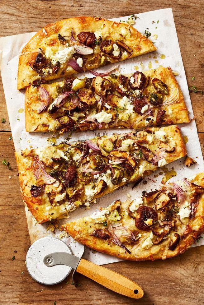 """<p>Shiitake mushrooms and two kinds of cheese elevate this pie beyond the typical red sauce pizza. The best part? You can get it on the table in 25 minutes! </p><p><em><a href=""""https://www.goodhousekeeping.com/food-recipes/a34386715/mushroom-brussels-sprouts-pizza-recipe/"""" rel=""""nofollow noopener"""" target=""""_blank"""" data-ylk=""""slk:Get the recipe for Mushroom and Brussels Sprout Pizza »"""" class=""""link rapid-noclick-resp"""">Get the recipe for Mushroom and Brussels Sprout Pizza »</a></em></p><p><strong><br>RELATED:</strong> <a href=""""https://www.goodhousekeeping.com/appliances/g34610991/best-home-pizza-ovens/"""" rel=""""nofollow noopener"""" target=""""_blank"""" data-ylk=""""slk:7 Best Home Pizza Ovens of 2020"""" class=""""link rapid-noclick-resp"""">7 Best Home Pizza Ovens of 2020</a><em><br></em></p>"""