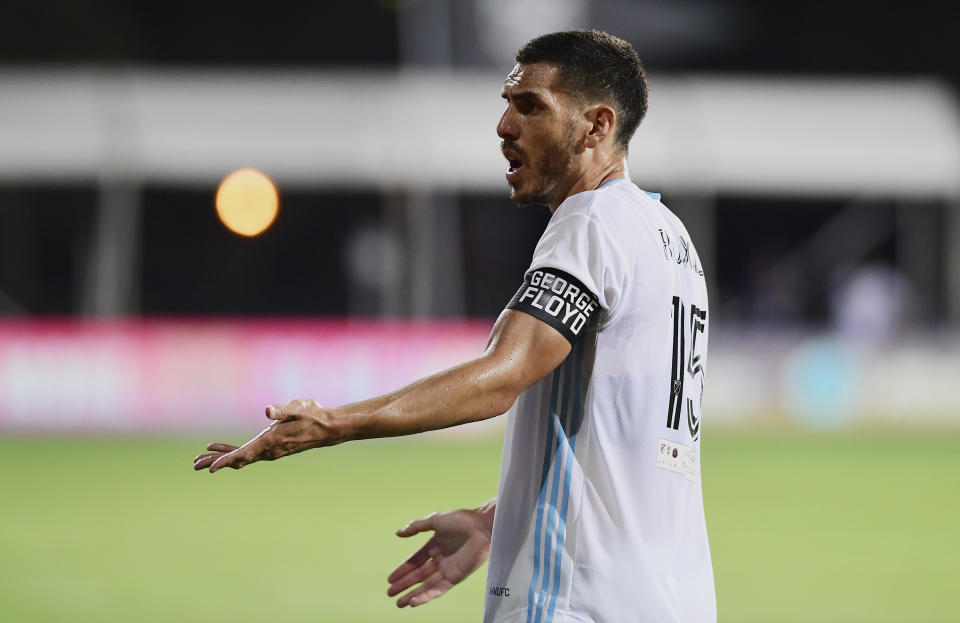 Minnesota United captain Michael Boxall sported an armband bearing George Floyd's name against Sporting Kansas City. (Emilee Chinn/Getty Images)