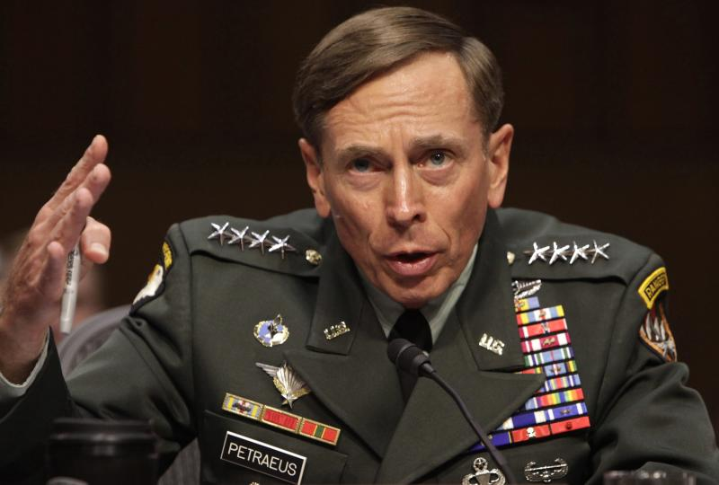 U.S. General David Petraeus gestures during the Senate Intelligence Committee hearing on his nomination to be director of the Central Intelligence Agency in Washington, in this file photo taken June 23, 2011. Petraeus has pleaded guilty in federal court to a charge of unauthorized removal and retention of classified information, the U.S. Justice Department said on Tuesday.  REUTERS/Yuri Gripas/Files   (UNITED STATES - Tags: POLITICS MILITARY CRIME LAW)