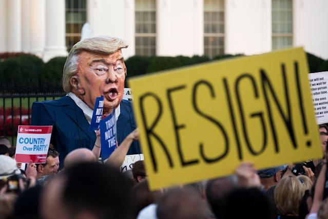 "<p>An oversized puppet depicting the image of President J. Trump that is labeled ""Putin's Puppet"" is seen in a crowd of hundreds of people participating in a national vigil on Pennsylvania Avenue outside the White House in Washington, D.C., on July 18, 2018. (Photo: Michael Reynolds/EPA-EFE/REX/Shutterstock) </p>"