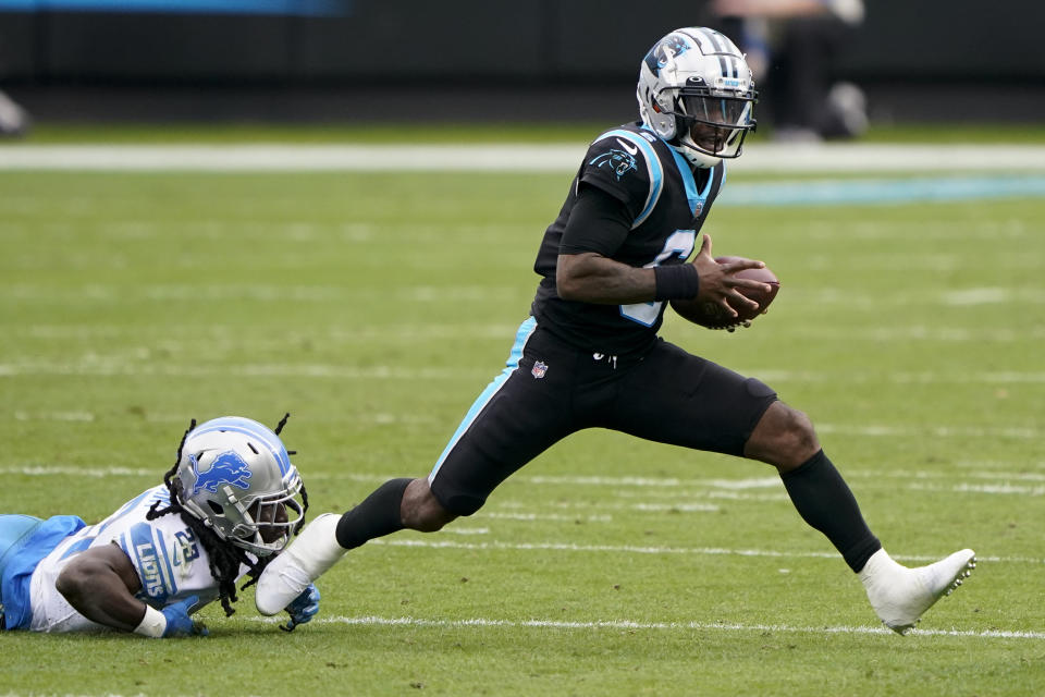 Carolina Panthers quarterback P.J. Walker breaks way from Detroit Lions cornerback Desmond Trufant during the first half of an NFL football game Sunday, Nov. 22, 2020, in Charlotte, N.C. (AP Photo/Brian Blanco)