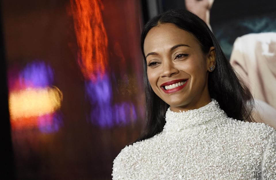 "Zoe Saldana, a cast member in ""Live by Night,"" poses at the premiere of the film at the TCL Chinese Theatre on Monday, Jan. 9, 2017 in Los Angeles. (Photo by Chris Pizzello/Invision/AP)"