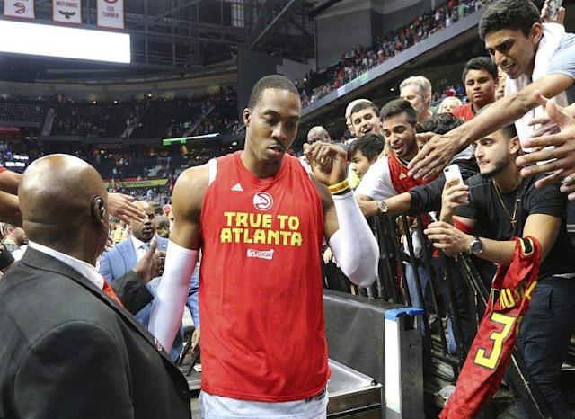"""<a class=""""link rapid-noclick-resp"""" href=""""/nba/players/3818/"""" data-ylk=""""slk:Dwight Howard"""">Dwight Howard</a> walks off the court after the Hawks were eliminated at home in Game 6. (AP)"""
