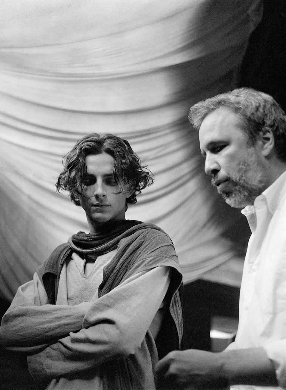 """<p>Taking photos on set, especially during moments that would otherwise be downtime for a cinematographer, gave Fraser a different view of interactions between Villeneuve (seen here with Chalamet) and the cast.</p> <p>""""So while the director and actors are talking, I'm watching them talk and watching subtle little things happen, which ordinarily I wouldn't be tuned into if I wasn't in the act of taking a photograph,"""" Fraser said.</p>"""