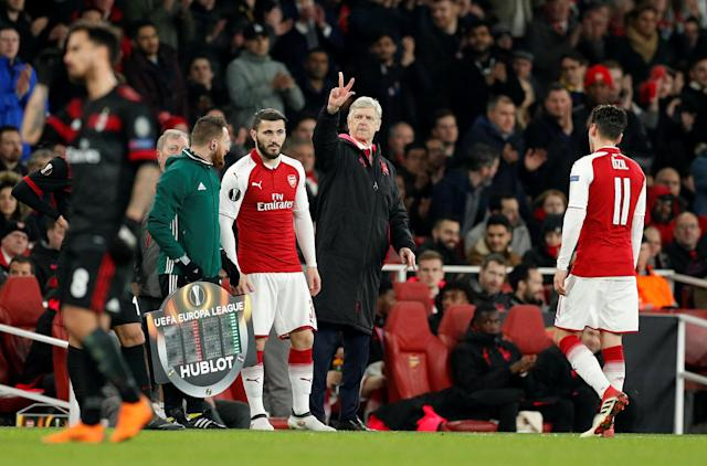 Soccer Football - Europa League Round of 16 Second Leg - Arsenal vs AC Milan - Emirates Stadium, London, Britain - March 15, 2018 Arsenal's Sead Kolasinac comes on as a substitute to replace Mesut Ozil as manager Arsene Wenger looks on Action Images via Reuters/John Sibley