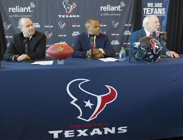 Former Penn State head coach and New England Patriots offensive coordinator Bill O'Brien, left, attends a press conference where he was introduced as the new head coach of the Houston Texans NFL football team, with general manager Rick Smith, center, and owner Bob McNair, Friday, Jan. 3, 2014, in Houston. (AP Photo/Patric Schneider)