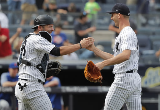 New York Yankees relief pitcher Chasen Shreve, right, celebrates with catcher Austin Romine, left, after they defeated the New York Mets in a baseball game, Saturday, July 21, 2018, in New York. (AP Photo/Julie Jacobson)