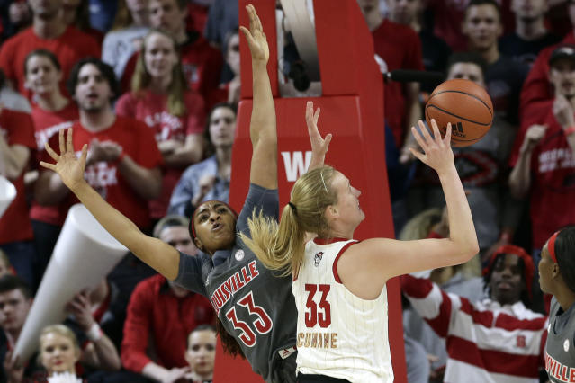 Louisville forward Bionca Dunham, left, defends against North Carolina State center Elissa Cunane during the first half of an NCAA college basketball game in Raleigh, N.C., Thursday, Feb. 13, 2020. (AP Photo/Gerry Broome)