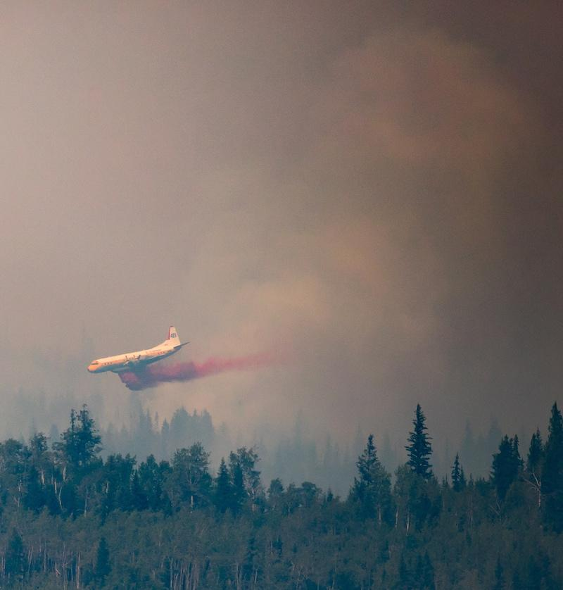 <p>A tanker drops retardant while battling the Shovel Lake wildfire near Fraser Lake, B.C. on Friday Aug. 17, 2018. (Photo from The Canadian Press/Darryl Dyck) </p>