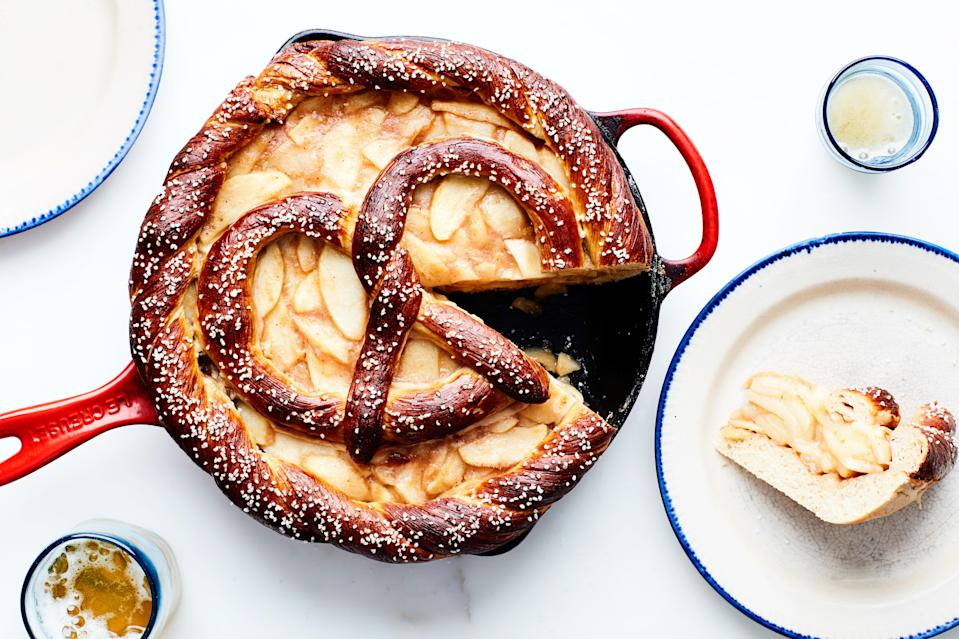 """A soft-pretzel crust and a giant salted-pretzel topper take the place of traditional pie dough in this fun twist on apple pie. <a href=""""https://www.epicurious.com/recipes/food/views/salted-apple-pretzel-pie?mbid=synd_yahoo_rss"""" rel=""""nofollow noopener"""" target=""""_blank"""" data-ylk=""""slk:See recipe."""" class=""""link rapid-noclick-resp"""">See recipe.</a>"""
