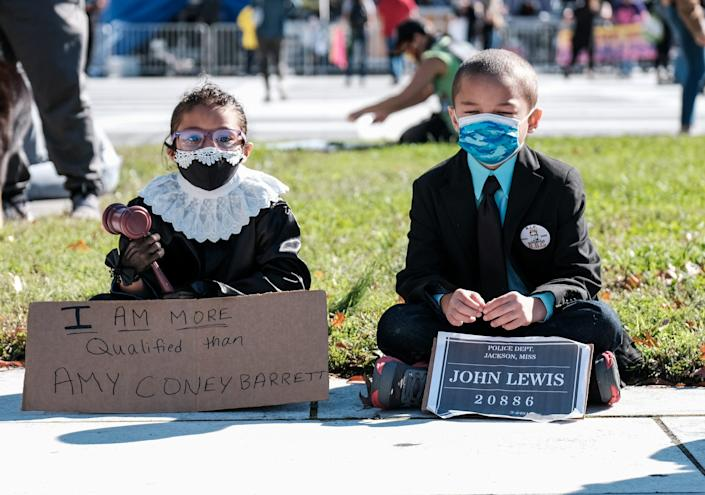 A child dressed up as RBG