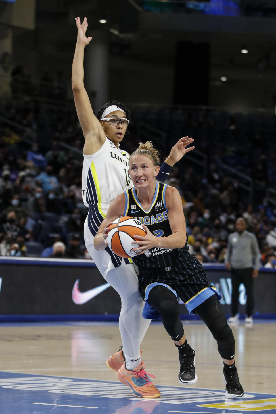 Chicago Sky guard Courtney Vandersloot (22) drives to the basket past Dallas Wings guard Allisha Gray (15) during the first half in the first round of the WNBA basketball playoffs, Thursday, Sept. 23, 2021, in Chicago. (AP Photo/Kamil Krzaczynski)