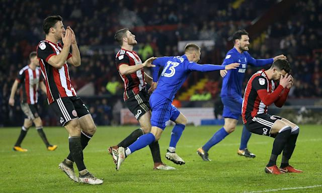 Anthony Pilkington celebrates as Sheffield United players react to his late equaliser.