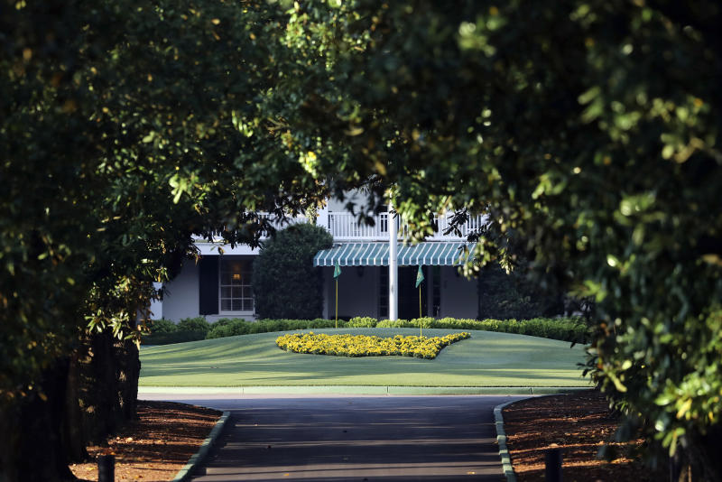 Augusta National Golf Club, seen down Magnolia Lane, is well manicured on what would have been the first practice round for the Masters golf tournament, Monday, April 6, 2020, in Augusta, Ga. The 2020 Masters, postponed because of the coronavirus pandemic, is slated to take place on Nov. 12-15. (Curtis Compton/Atlanta Journal-Constitution via AP)