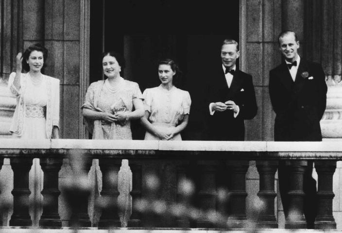 FILE - In this July 10, 1947 file photo, the newly betrothed royal couple, Princess Elizabeth, left, and Lieut. Philip Mountbatten, right, appear on the balcony of Buckingham Palace in London, with King George VI and Queen Elizabeth and Princess Margaret, center. Buckingham Palace officials say Prince Philip, the husband of Queen Elizabeth II, has died, it was announced on Friday, April 9, 2021. He was 99. Philip spent a month in hospital earlier this year before being released on March 16 to return to Windsor Castle. (AP Photo/File)