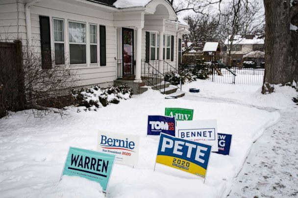 PHOTO: Campaign signs for 2020 Democratic presidential candidates stand in snow outside a home in Des Moines, Iowa, Jan. 30, 2020. (Bloomberg via Getty Images, FILE)