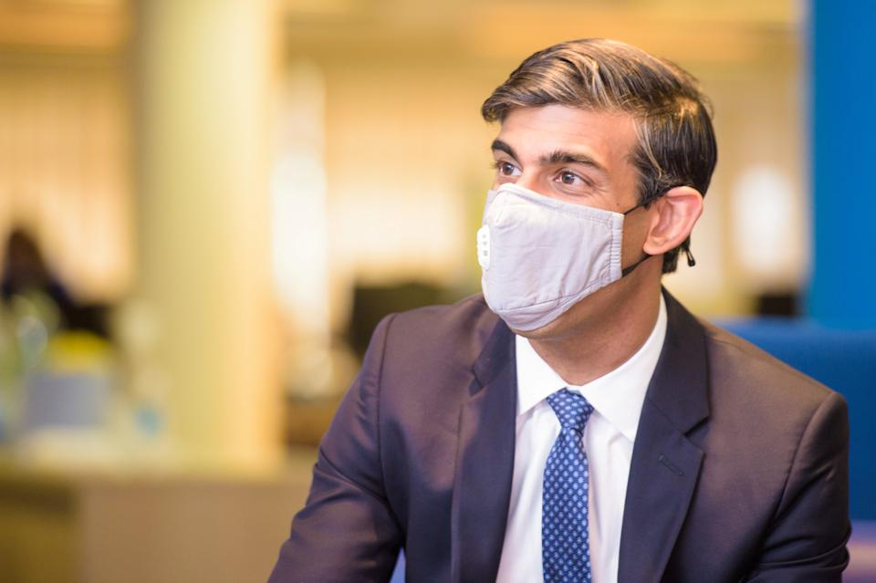Britain's Chancellor of the Exchequer Rishi Sunak wearing a face mask visits the Jobcentre Plus to see the new support being provided in job centres by the doubling of work coaches, following the coronavirus disease (COVID-19) outbreak in Barking, east London, Britain July 16, 2020. Anthony Upton/Pool via REUTERS