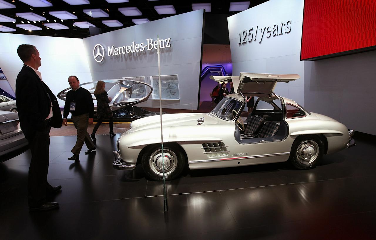 DETROIT, MI - JANUARY 11:  Journalists look over a 1954 Mercedes-Benz 300SL during the press preview of the North American International Auto Show at the Cobo Center on January 11, 2011 in Detroit, Michigan. The show is currently opened only for media previews and opens to the general public January 15-23.  (Photo by Scott Olson/Getty Images)