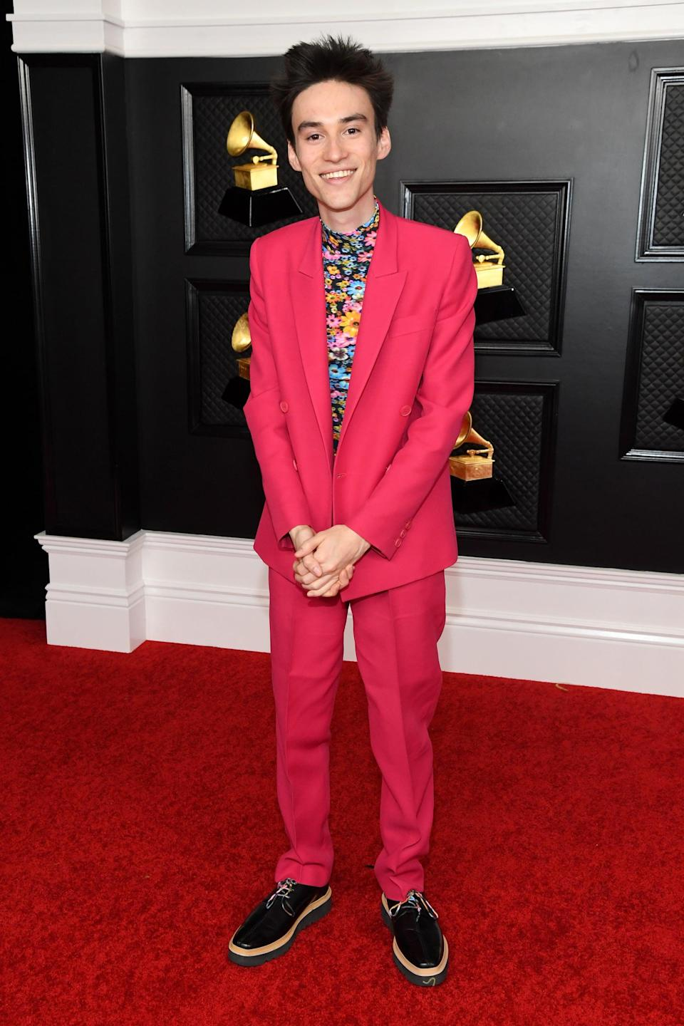 <p>Jacob Collier arrived in a hot pink Stella McCartney Suit layered over a floral turtleneck.</p>