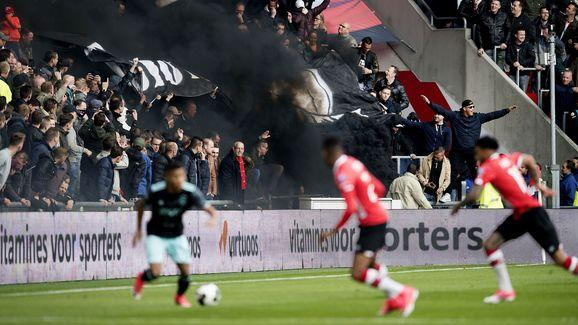 Five football fans were taken to hospital with breathing difficulties after an Eredivisie game between PSV Eindhoven and Ajax saw thick smoke bombs let off just minutes in. ​ The unsavoury scenes (below courtesy of @ElzenHD) that unfolded on Sunday went viral on social media, and very much overshadowed the game, which finished 1-0 to hosts PSV thanks to a 25th minute strike from Jurgen Locadia. The smoke bombs were set off as early as the fifth minute of the crunch clash by the home fans, and...