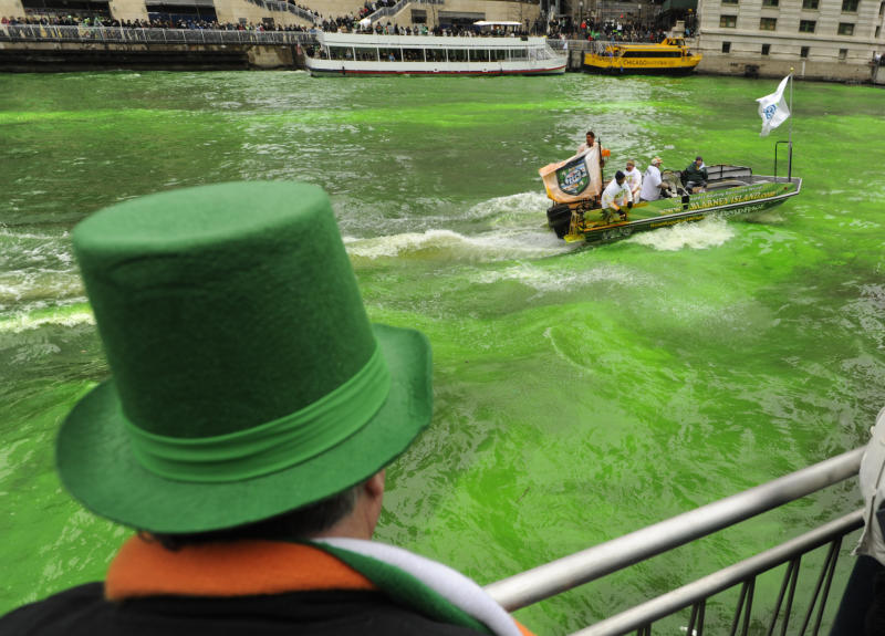 A spectator looks on as the Chicago River is dyed green ahead of the St. Patrick's Day parade in Chicago, Saturday, March, 16, 2013. With the holiday itself falling on a Sunday, many celebrations were scheduled for Saturday because of religious observances. (AP Photo/Paul Beaty)