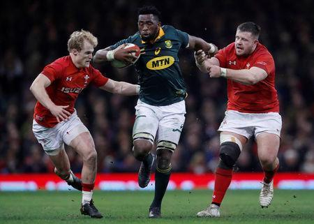 FILE PHOTO: Rugby Union - Autumn Internationals - Wales vs South Africa - Principality Stadium, Cardiff, Britain - December 2, 2017 South Africas' Siya Kolisi in action with Wales' Aled Davies and Rob Evans Action Images via Reuters/Andrew Boyers/File Photo