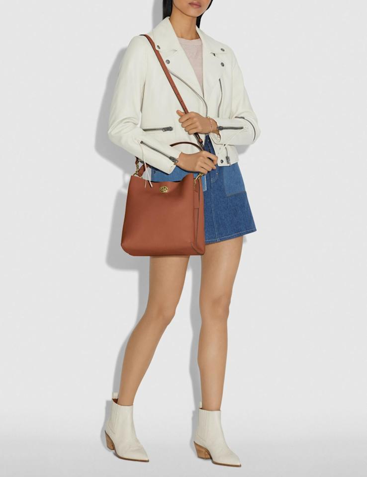 """<p>This <a href=""""https://www.popsugar.com/buy/Coach-Charlie-Bucket-Bag-456590?p_name=Coach%20Charlie%20Bucket%20Bag&retailer=coach.com&pid=456590&price=375&evar1=fab%3Aus&evar9=45929069&evar98=https%3A%2F%2Fwww.popsugar.com%2Ffashion%2Fphoto-gallery%2F45929069%2Fimage%2F46242782%2FCoach-Charlie-Bucket-Bag&list1=shopping%2Ccoach%2Caccessories%2Cbags%2Cshoppping&prop13=mobile&pdata=1"""" rel=""""nofollow"""" data-shoppable-link=""""1"""" target=""""_blank"""" class=""""ga-track"""" data-ga-category=""""Related"""" data-ga-label=""""https://www.coach.com/coach-charlie-bucket-bag/55200.html?cgid=women-handbags-charlie&amp;dwvar_color=SVAOM"""" data-ga-action=""""In-Line Links"""">Coach Charlie Bucket Bag</a> ($375) features two convenient straps. </p>"""