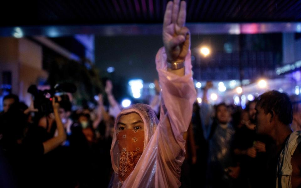 The three-finger salute has become a symbol for the protesters - AFP