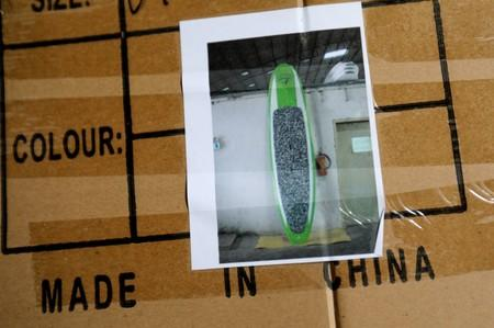 A Doyle surfboard manufactured in China are shown in its shipping box in a warehouse in Lake Forest, California