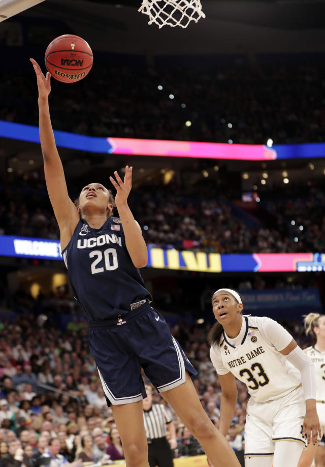 Connecticut forward Olivia Nelson-Ododa (20) aims to score during the first half of a women's Final Four NCAA college basketball semifinal tournament game against Notre Dame, Friday, April 5, 2019, in Tampa, Fla. Notre Dame forward Danielle Patterson (33) watches. (AP Photo/John Raoux)