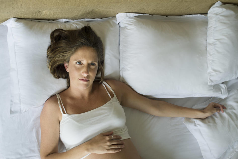 It is advised to avoid sleeping on your back when pregnant, especially in the third trimester. Source: Getty