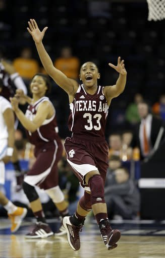 Texas A&M guard Courtney Walker (33) reacts as time expires in their 66-62 win over Tennessee ina n NCAA college basketball game at the Southeastern Conference tournament, Saturday, March 9, 2013, in Duluth, Ga. (AP Photo/John Bazemore)