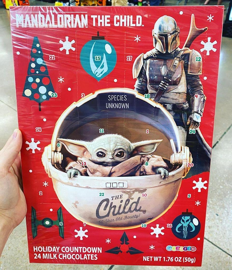 "<p>Fans of ""The Child"" (known to many as Baby Yoda) from Disney+'s <em>The Mandalorian</em> will be pleased to know that he's popping up on a ton of different gifts this holiday season. One of our faves is this advent calendar spotted at Kroger by <a href=""https://www.instagram.com/p/CGN8576FCop/"" rel=""nofollow noopener"" target=""_blank"" data-ylk=""slk:Instagrammer @foodymama"" class=""link rapid-noclick-resp"">Instagrammer @foodymama</a>. It's filled with 24 milk chocolates and features an adorable photo of the little guy himself on the front. </p>"