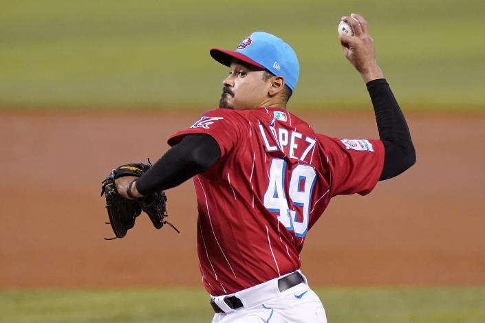 Miami Marlins starting pitcher Pablo Lopez (49) throws during the first inning of a baseball game against the New York Mets, Saturday, May 22, 2021, in Miami. (AP Photo/Lynne Sladky)