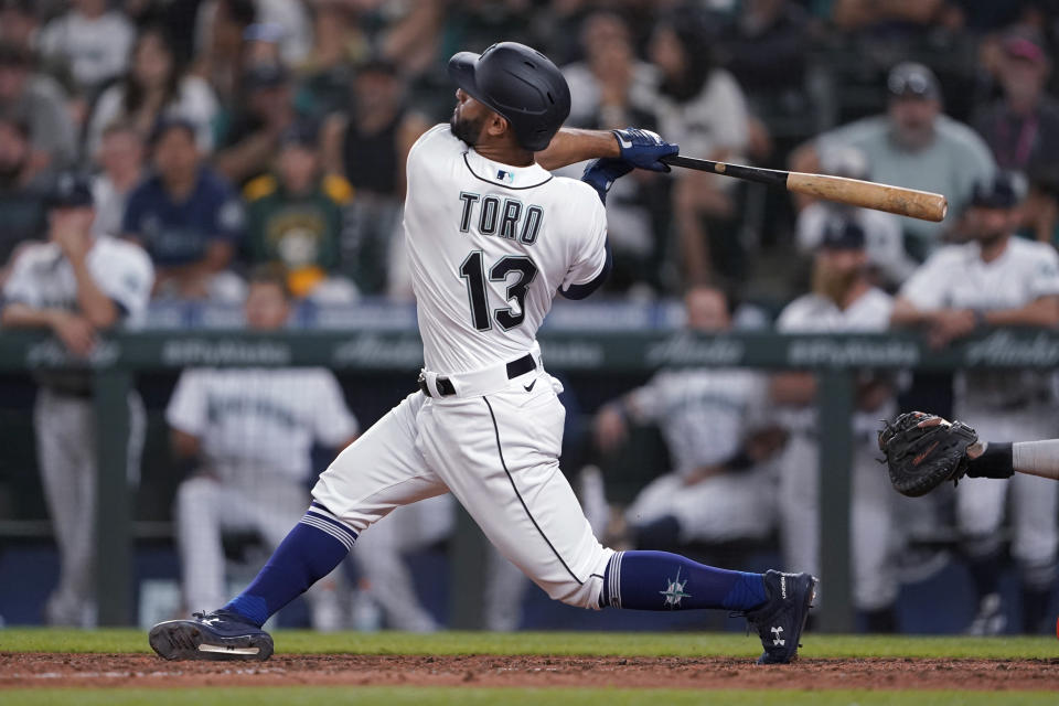 Seattle Mariners' Abraham Toro hits a two-run home run against the Houston Astros during the ninth inning of a baseball game Tuesday, July 27, 2021, in Seattle. Toro was traded to the Mariners from the Astros earlier in the day. The Astros won 8-6. (AP Photo/Ted S. Warren)