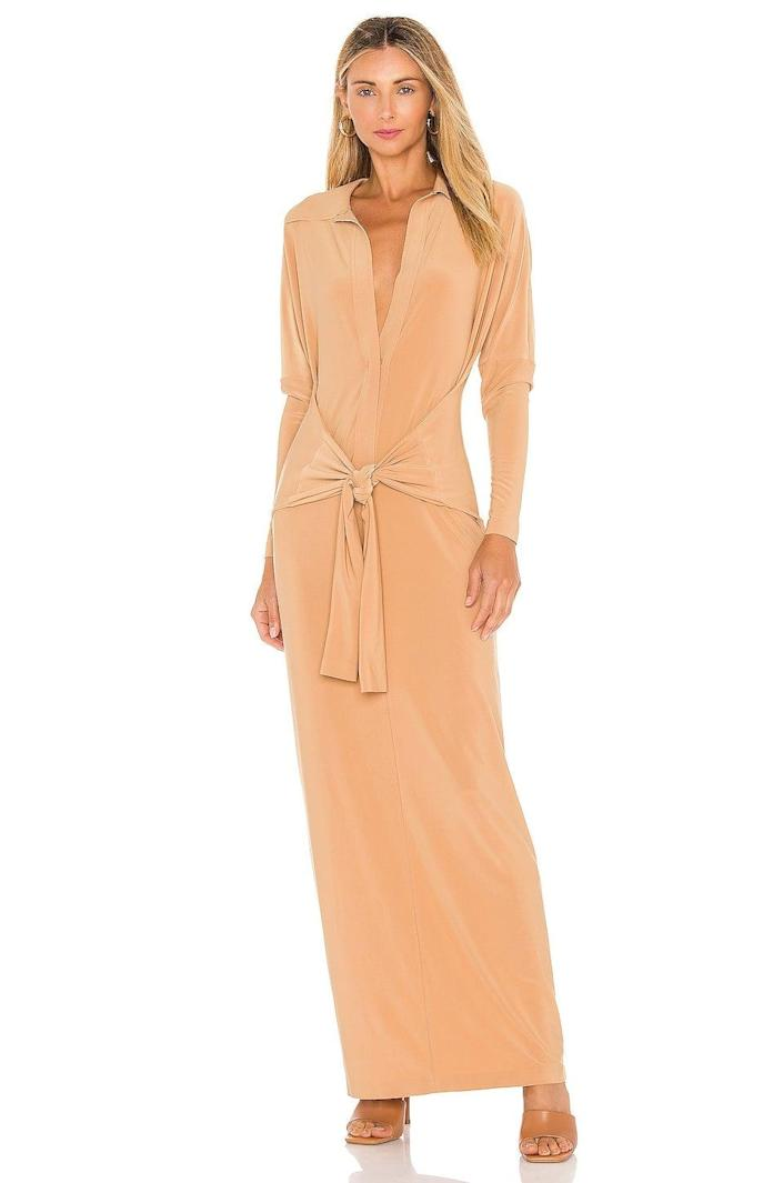 """<h2>Norma Kamali Ty Front NK Midcalf Shirt Dress</h2><br><strong><em>The Night-Out-On-The-Town Option</em></strong><br><br>For a dress that's a little bit maxi and <em>a lot</em> of sexy, look no further than this slinky Norma Kamali number featuring a long hem and a low neckline. <br><br><strong>The Hype: </strong>4.5 out of 5 stars; 6 reviews on Revolve.com<br><br><strong>What They're Saying</strong>: """"This is perfect. Hides all flaws on the mid section. Very flattering. Can't wait to hit the town. Fabric a little heavy. Probably best for a time out in the fall."""" — Anonymous, Revolve reviewer<br><br><em>Shop <strong><a href=""""https://www.revolve.com/norma-kamali-ty-front-nk-midcalf-shirt-dress/dp/NKAM-WD251/"""" rel=""""nofollow noopener"""" target=""""_blank"""" data-ylk=""""slk:Revolve"""" class=""""link rapid-noclick-resp"""">Revolve</a></strong></em><br><br><strong>Norma Kamali</strong> Ty Front NK Midcalf Shirt Dress, $, available at <a href=""""https://go.skimresources.com/?id=30283X879131&url=https%3A%2F%2Fwww.revolve.com%2Fnorma-kamali-ty-front-nk-midcalf-shirt-dress%2Fdp%2FNKAM-WD251%2F"""" rel=""""nofollow noopener"""" target=""""_blank"""" data-ylk=""""slk:Revolve"""" class=""""link rapid-noclick-resp"""">Revolve</a>"""