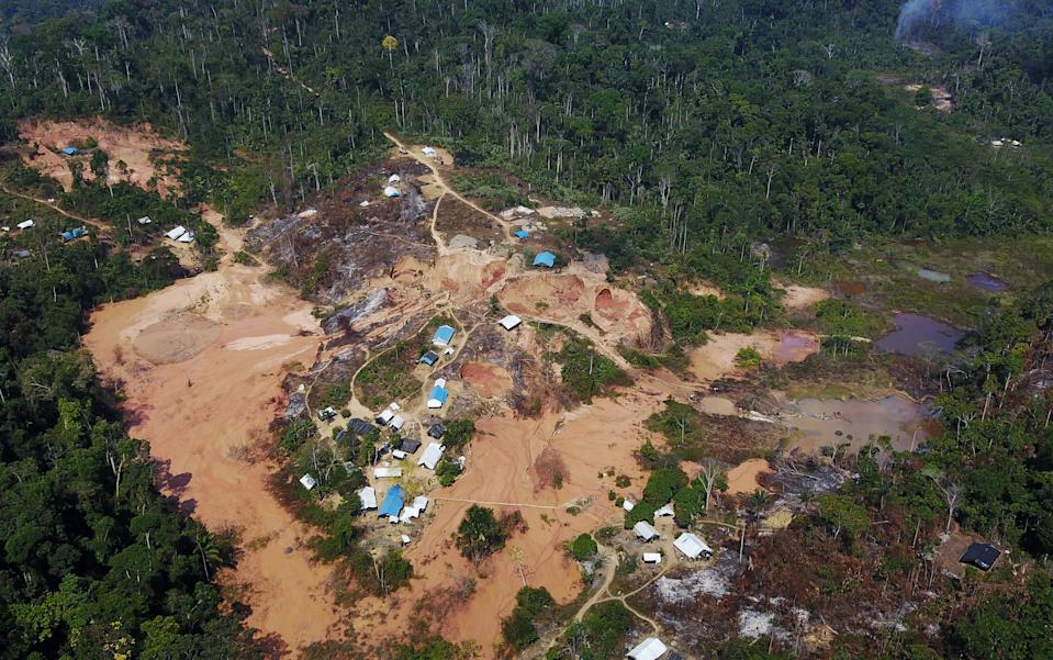 An aerial view show a wildcat gold mine, also known as a garimpo, at a deforested area of the Amazon rainforest near Crepurizao, in the municipality of Itaituba, Para State, Brazil, August 6, 2017. Picture taken with a drone. Picture taken August 6, 2017. REUTERS/Nacho Doce