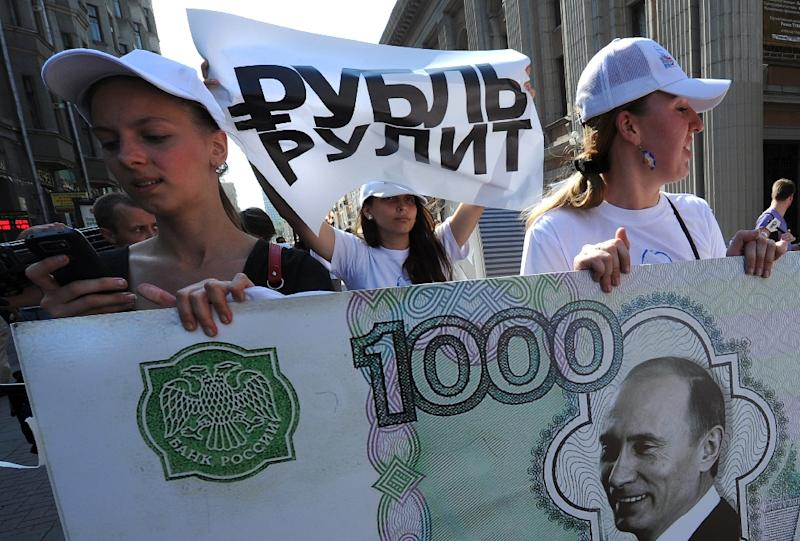 Russia will cut spending by 10% this year as oil prices slump to new lows (AFP Photo/Alexander Nemenov)