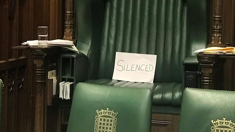 "A piece of paper with the word ""silenced"" sits on the chair of the speaker of the UK parliament, in protest against its suspension for longer than usual at a critical time in British politics"