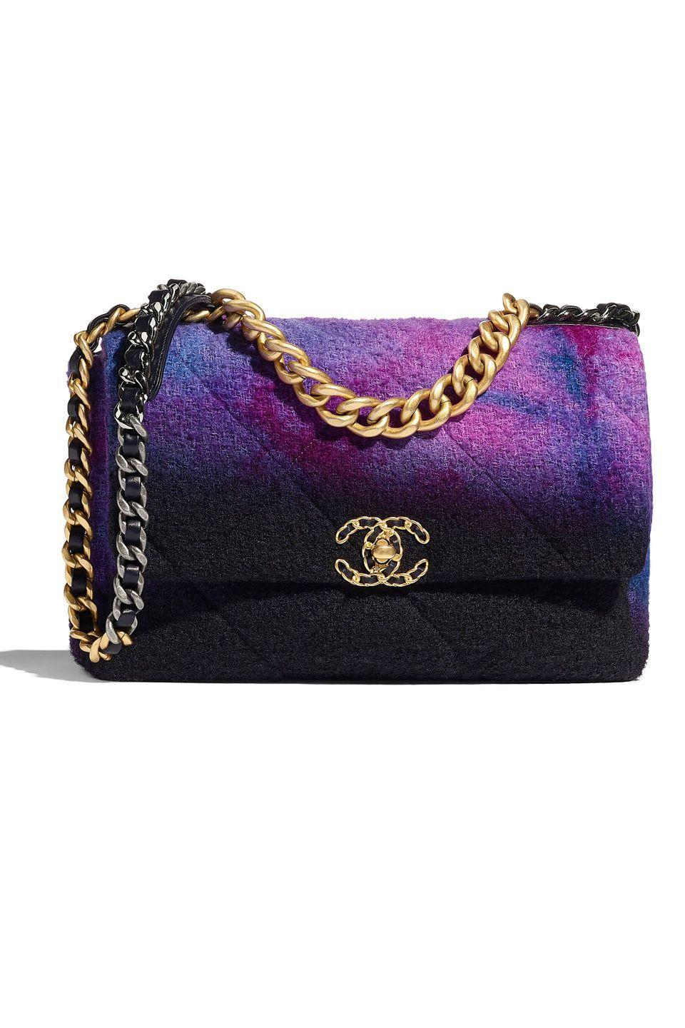 "<p>This handbag is a Venn Diagram center where Chanel lovers and goths collide. Reworking the Parisian house's classic flap bag in a moody purple, this subtle update will be sitting pretty in your closet for years to come. It also offers a genius solution for those of us who can never choose between gold and silver hardware: Why not both? </p><p><em>Chanel, $4,800; chanel.com</em></p><p><a class=""link rapid-noclick-resp"" href=""https://go.redirectingat.com?id=74968X1596630&url=https%3A%2F%2Fwww.chanel.com%2Fus%2Ffashion%2Fp%2FAS1161B03641N7619%2Fchanel-19-large-flap-bag-wool-tweed-gold-tone-silver-tone-ruthenium-finish-metal%2F&sref=https%3A%2F%2Fwww.elle.com%2Ffashion%2Fshopping%2Fg33416567%2Fdesigner-it-bags-pre-fall-2021%2F"" rel=""nofollow noopener"" target=""_blank"" data-ylk=""slk:SHOP NOW"">SHOP NOW</a></p>"