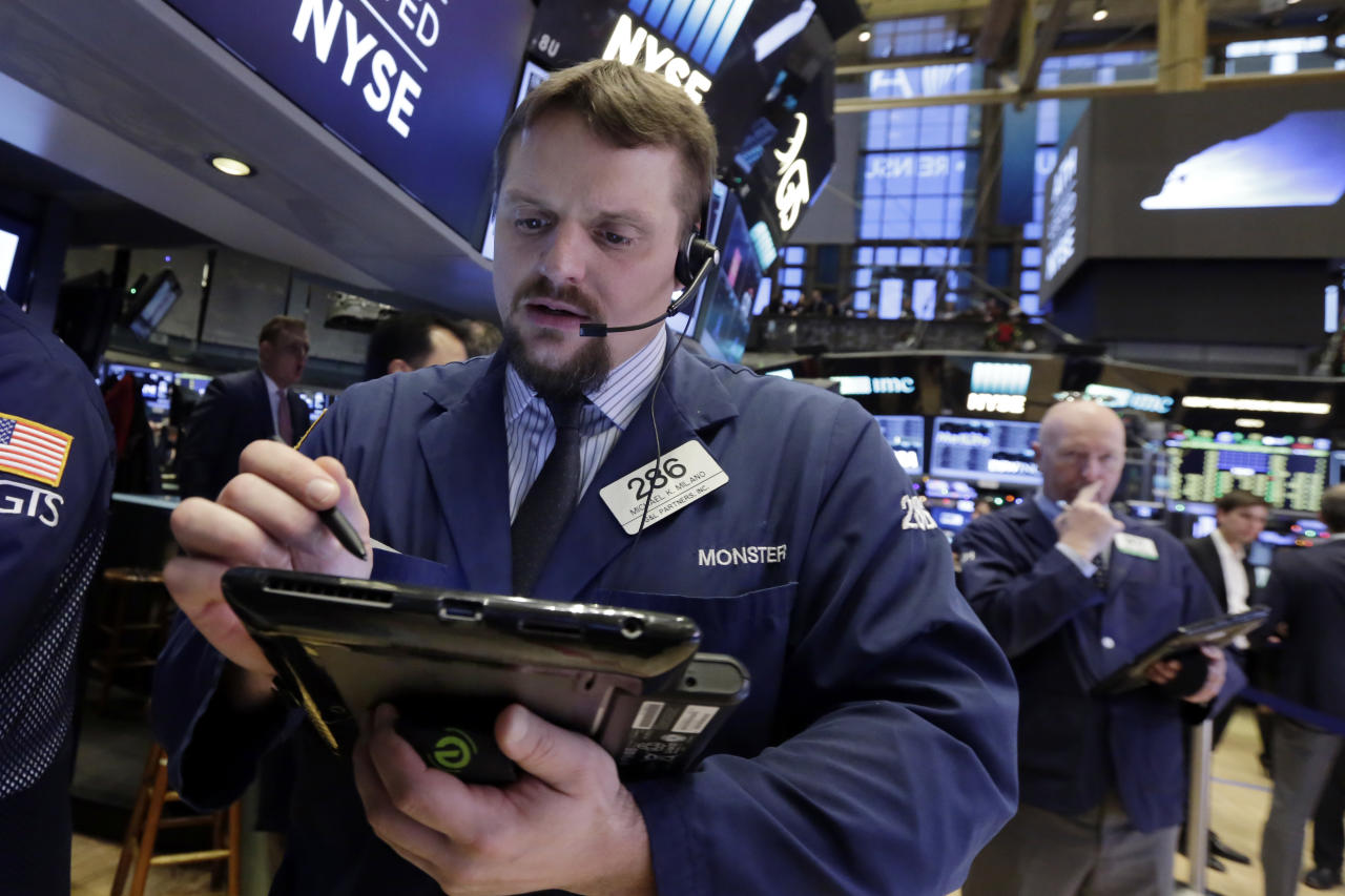<p> Trader Michael Milano, left, works on the floor of the New York Stock Exchange, Friday, Dec. 9, 2016. U.S. stocks are opening higher Friday morning as major indexes continue to set records. (AP Photo/Richard Drew) </p>