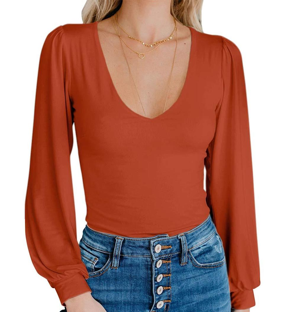 """<h3><h2>Spadehill Bell-Sleeved Bodysuit</h2></h3><br>A subtle, drape-y bell sleeve and smooth fabrication earned this elegant v-neck bodysuit a 4-star rating on Amazon.<br><br><strong>Spadehill</strong> V-Neck Long Sleeve Bodysuit, $, available at <a href=""""https://amzn.to/3bhoYqb"""" rel=""""nofollow noopener"""" target=""""_blank"""" data-ylk=""""slk:Amazon"""" class=""""link rapid-noclick-resp"""">Amazon</a>"""