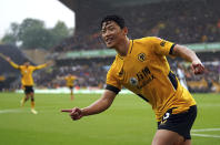 Wolverhampton Wanderers' Hwang Hee-chan celebrates after scoring his side's opening goal during the English Premier League soccer match between Wolverhampton Wanderers and Newcastle United at Molineux stadium in Wolverhampton, England, Saturday, Oct. 2, 2021. (Nick Potts/PA via AP)