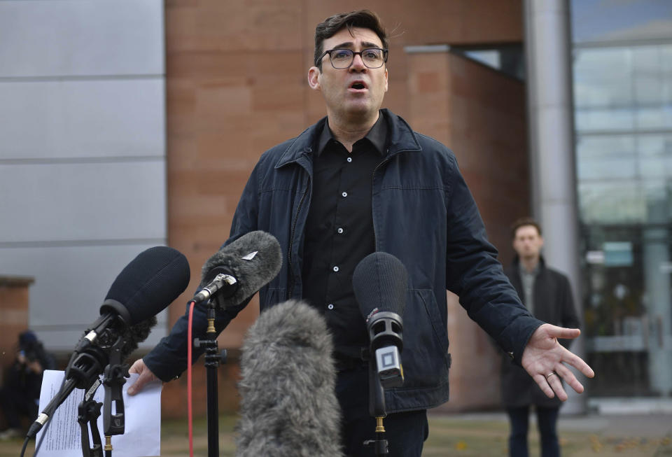 Greater Manchester mayor Andy Burnham speaks to the media outside Bridgewater Hall, following last-ditch talks with the Prime Minister aimed at securing additional financial support for his consent on new coronavirus restrictions, in Manchester, England, Tuesday, Oct. 20, 2020. The British government appeared poised Tuesday to impose strict coronavirus restrictions on England's second-largest city after talks with officials in Greater Manchester failed to reach an agreement on financial support for people whose livelihoods will be hit by the new measures. (Jacob King/PA via AP)
