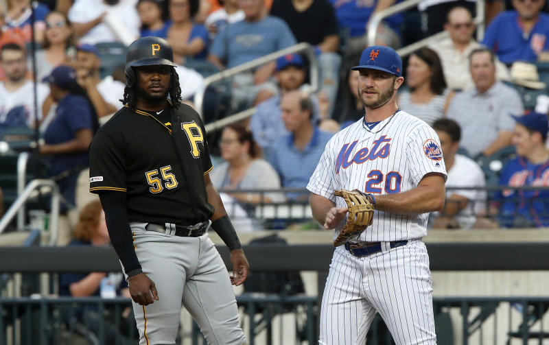 NEW YORK, NEW YORK - JULY 26: Josh Bell #55 of the Pittsburgh Pirates in action against Pete Alonso #20 of the New York Mets at Citi Field on July 26, 2019 in New York City. The Mets defeated the Pirates 6-3. (Photo by Jim McIsaac/Getty Images)