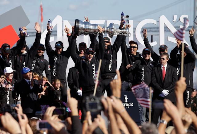 SAN FRANCISCO, CA - SEPTEMBER 25: Oracle Team USA skipper James Spithill celebrates with the America's Cup trophy after they beat Emirates Team New Zealand skippered by Dean Barker in race 19 to win the America's Cup Finals on September 25, 2013 in San Francisco, California. (Photo by Ezra Shaw/Getty Images)
